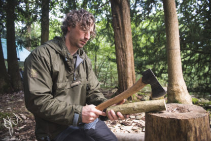bushcraft instructor using axe