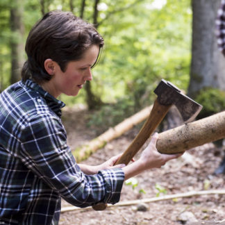 Bushcraft Instructor Heather splitting with Axe