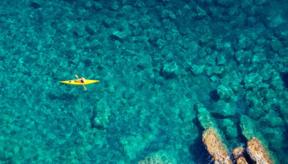 Sea kayaking in clear waters - Greece