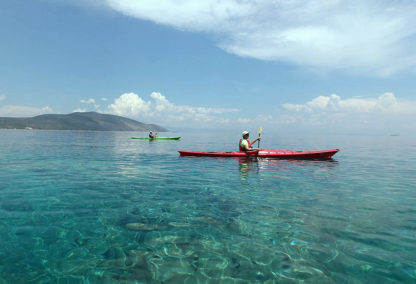 Paddling on crystal clear sea - Greece